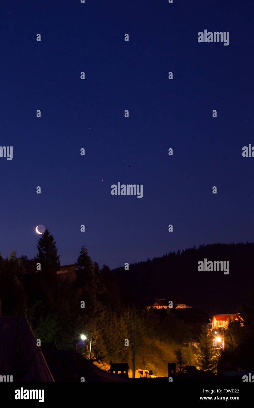 View of Azuga mountain resort by night - Stock Image