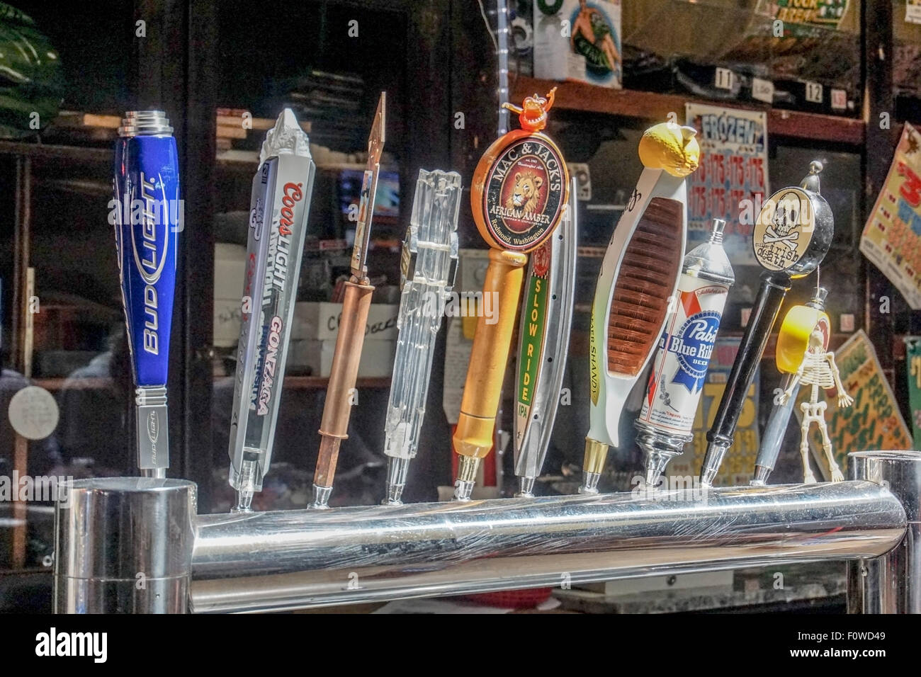 advertising on labeled handles draft beer are artifacts of time & place including national brands & local - Stock Image