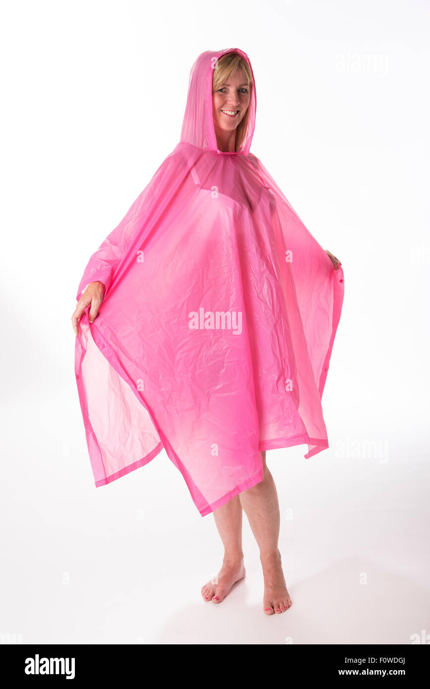 Woman dressed in a pink  Wearing a plastic rainwear poncho - Stock Image