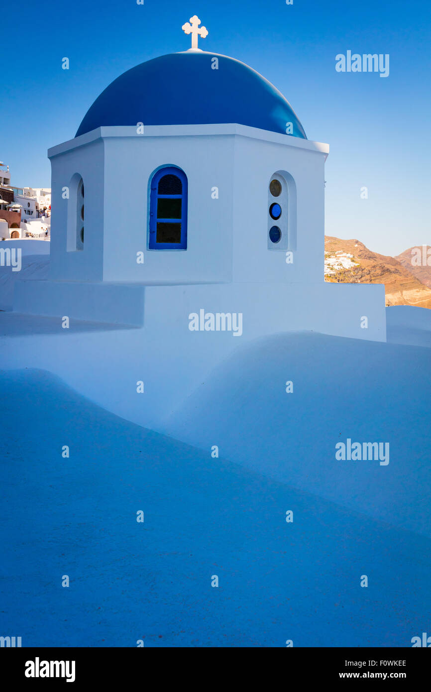 Iconic blue domed chapel in the town of Oia on the greek island Santorini (Thera) - Stock Image
