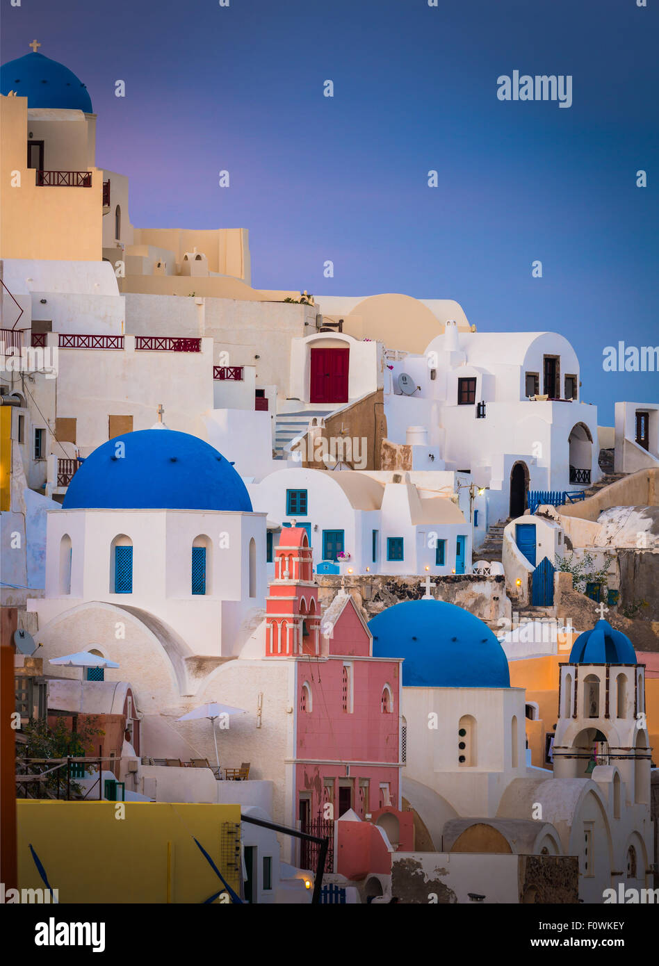 Iconic sunset in the town of Oia on the greek island Santorini (Thera) - Stock Image