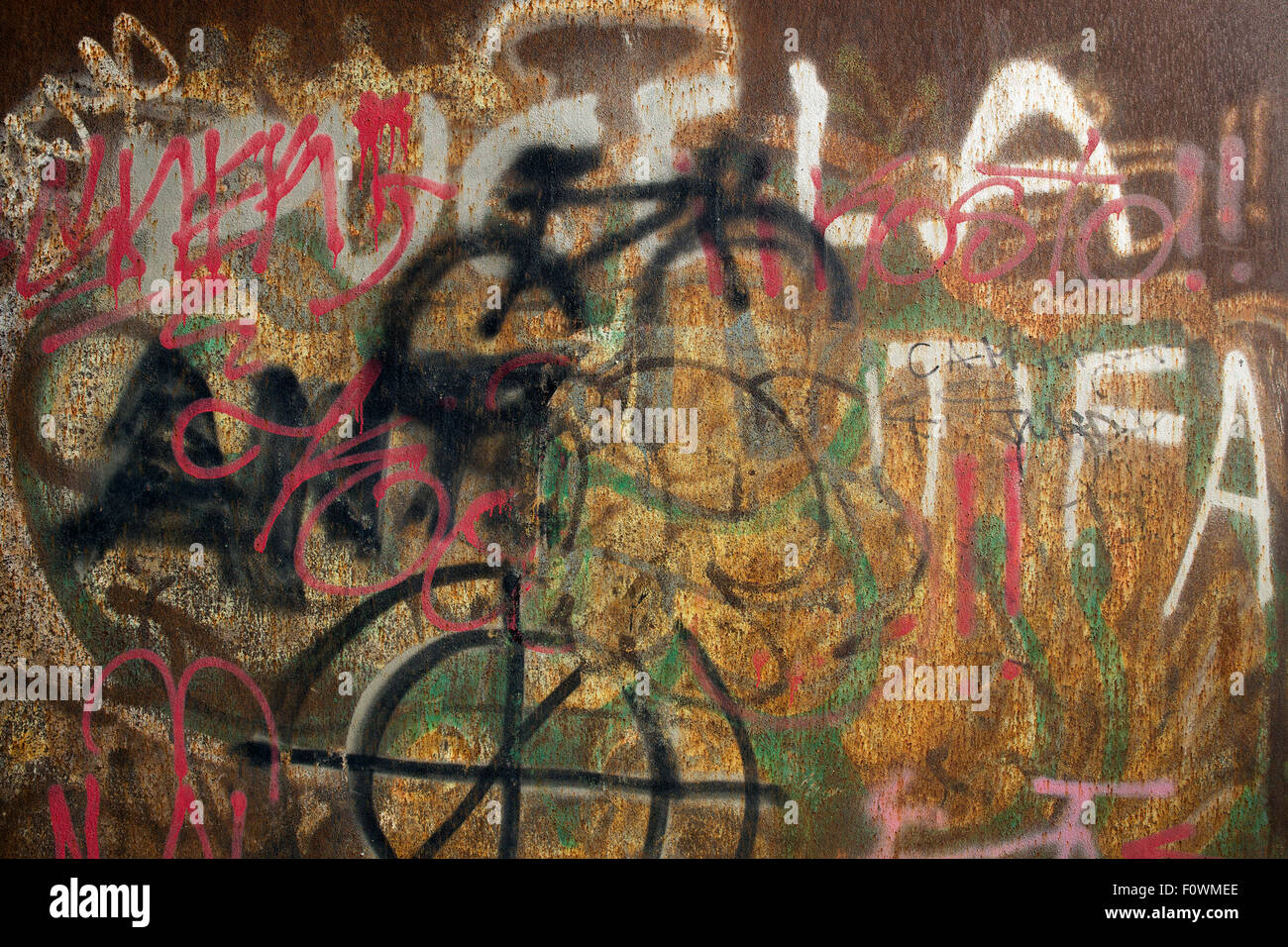 painted on a wall of iron - Stock Image