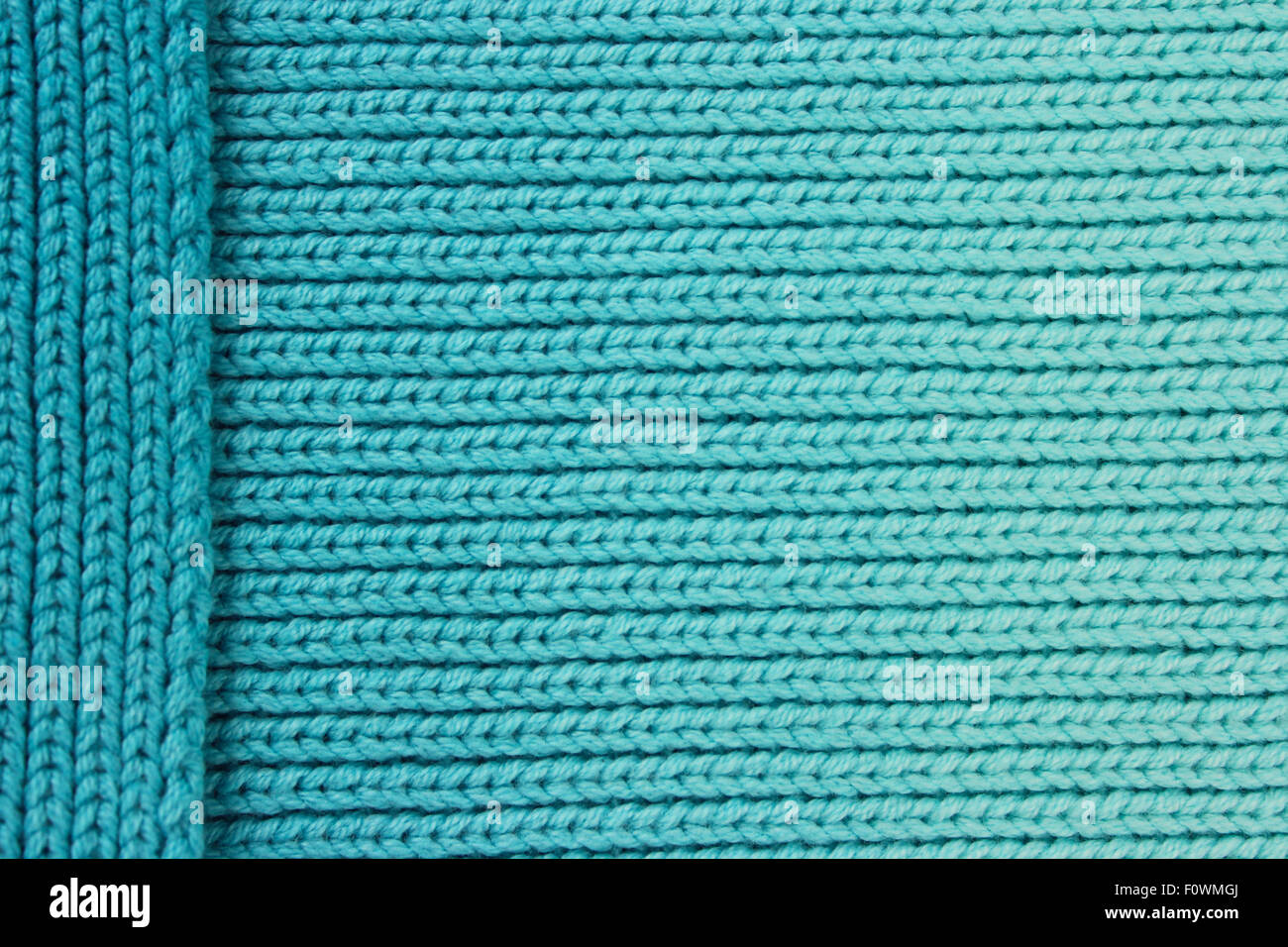 Turquoise wool background with layered side piece - Stock Image