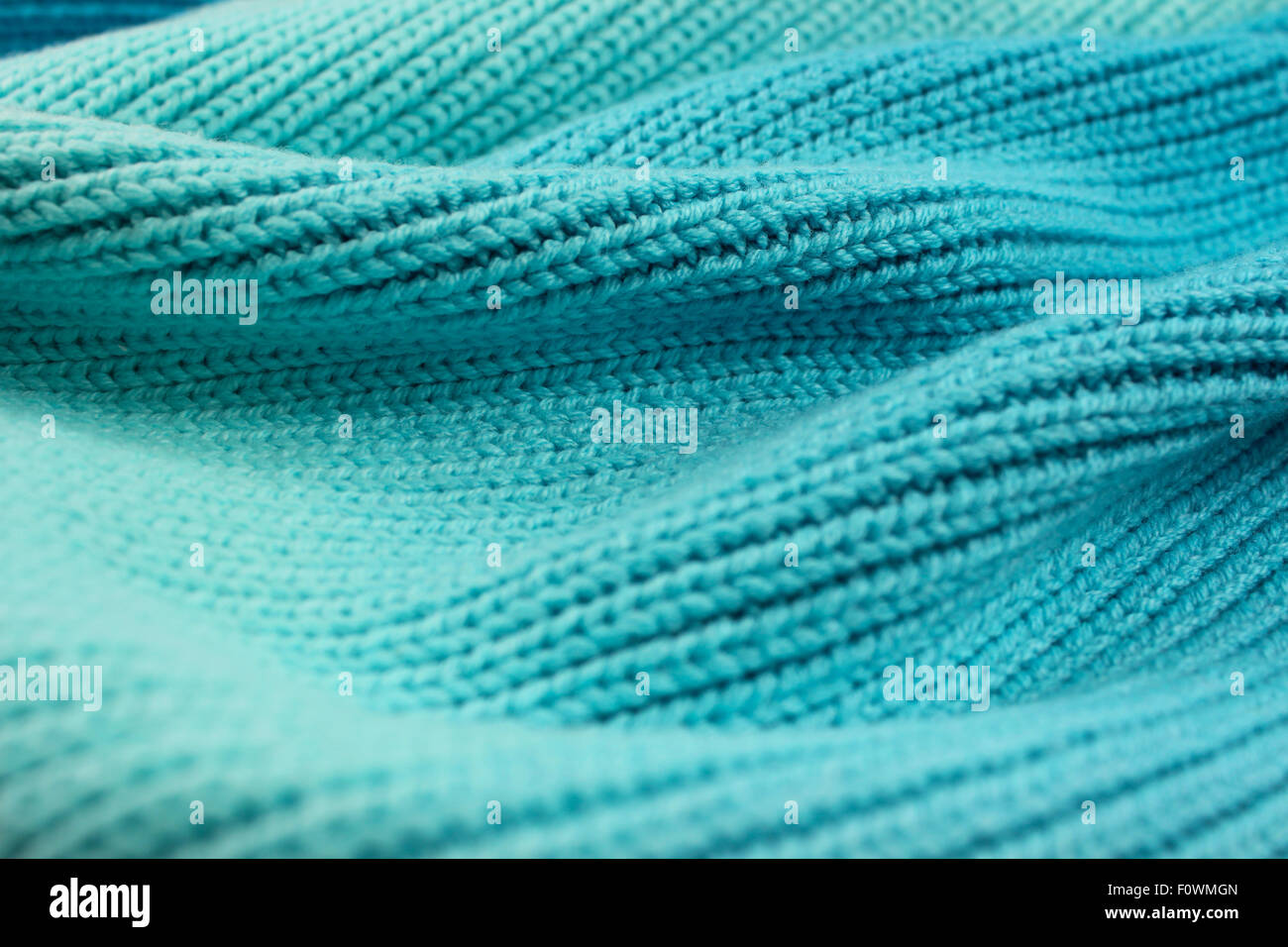 Knitted graduated turquoise shades of wool wave effect background - Stock Image
