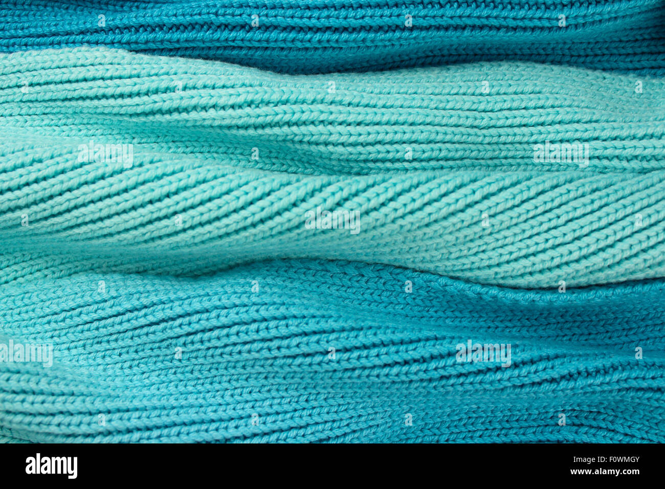 Turquoise wool wave effect background. - Stock Image