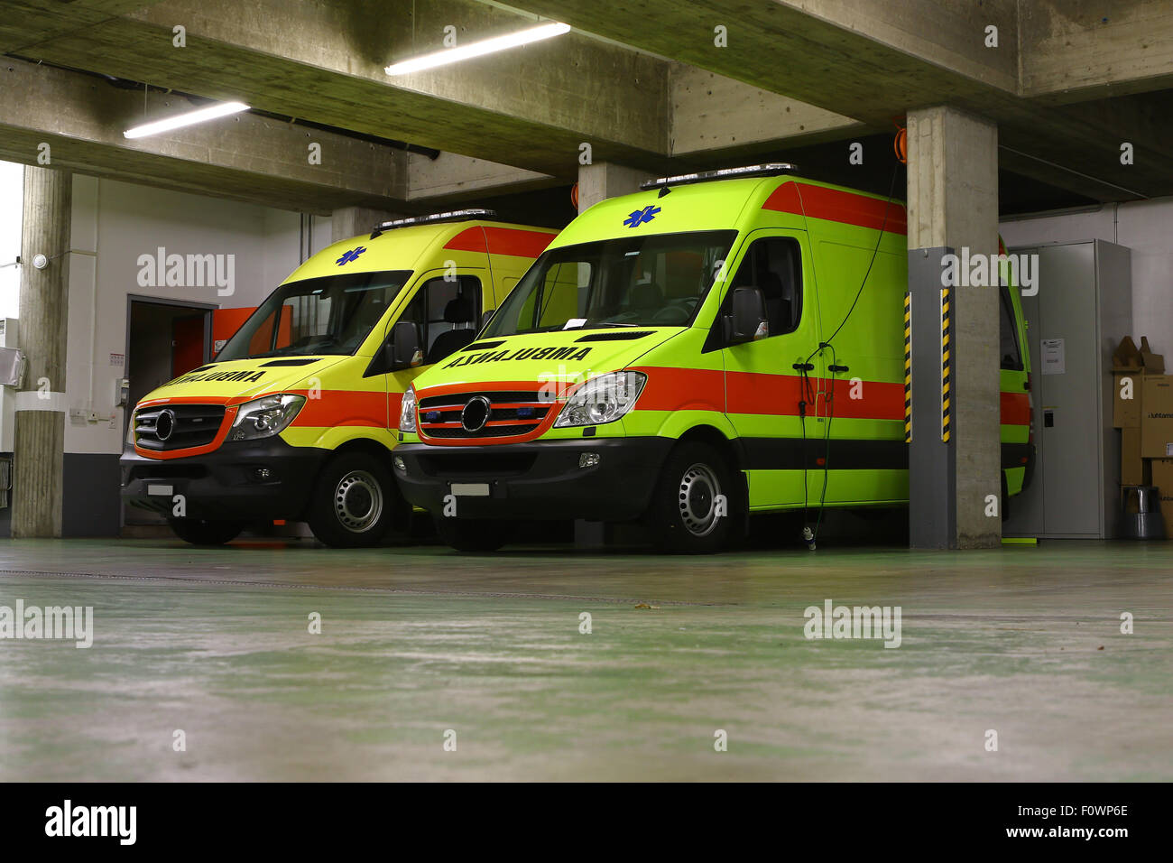Emergency vehicles, parked yellow ambulance - Stock Image