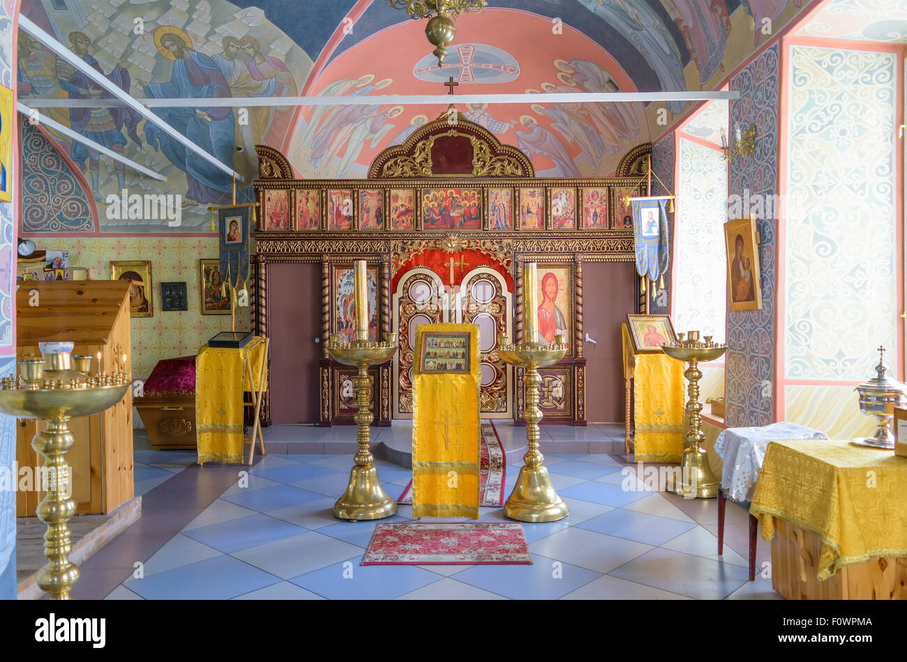 BOLHOV OF OREL REGION, RUSSIA - AUGUST 15, 2015: Several lectern and candlesticks in hall of worship in Holy Trinity - Stock Image