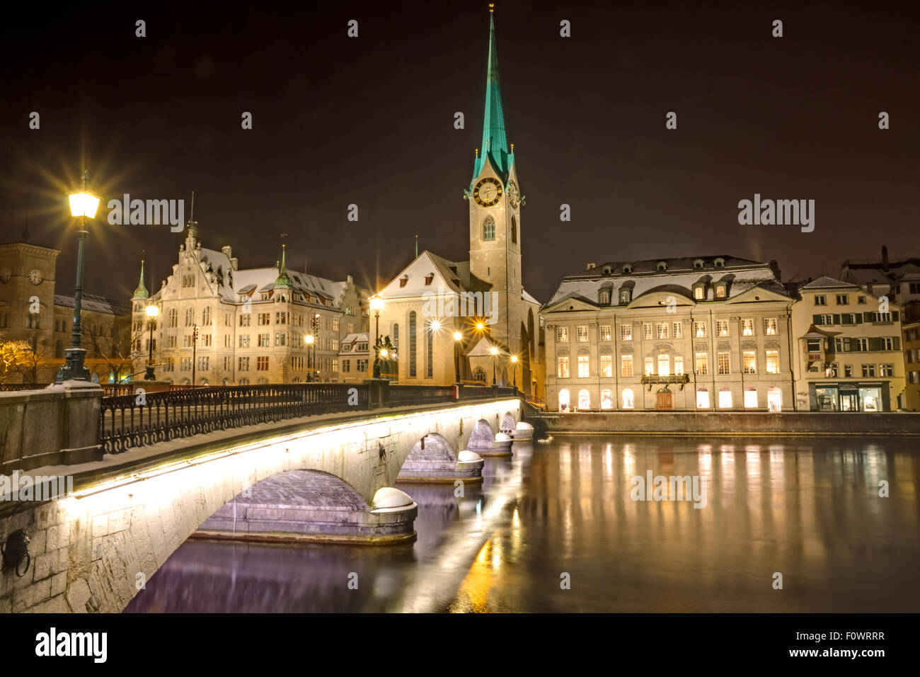 Nightscene at the banks of river Limmat in Zurich - Stock Image