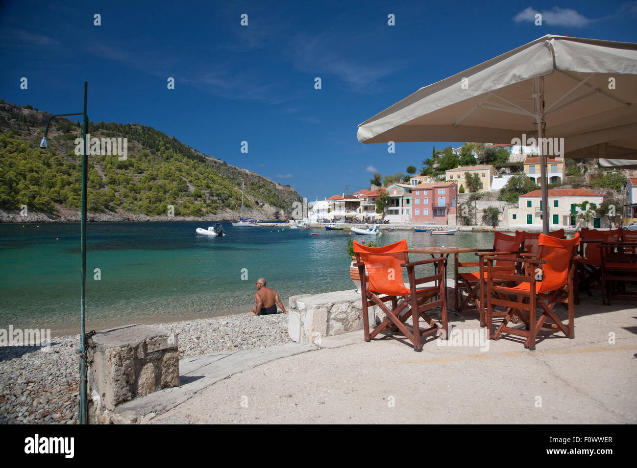 A taverna in the Bay of Assos, on the Greek Island of Kefalonia, home to the film, 'Captain Corelli's Mandolin' - Stock Image