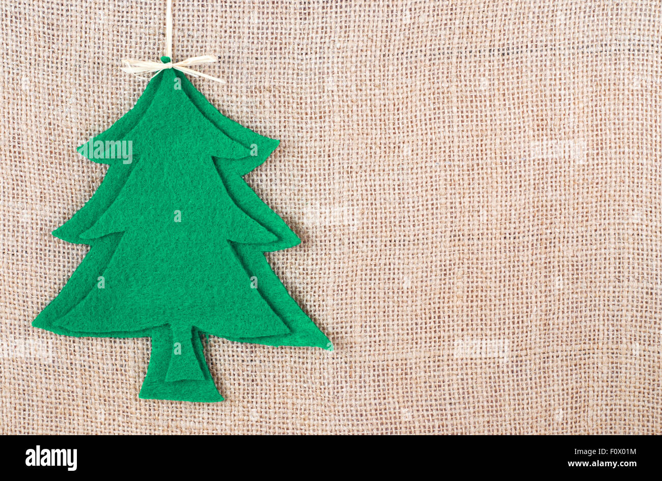 Rustic Christmas Image With Tree Cut Out Of Felt On Burlap Background Copyspace