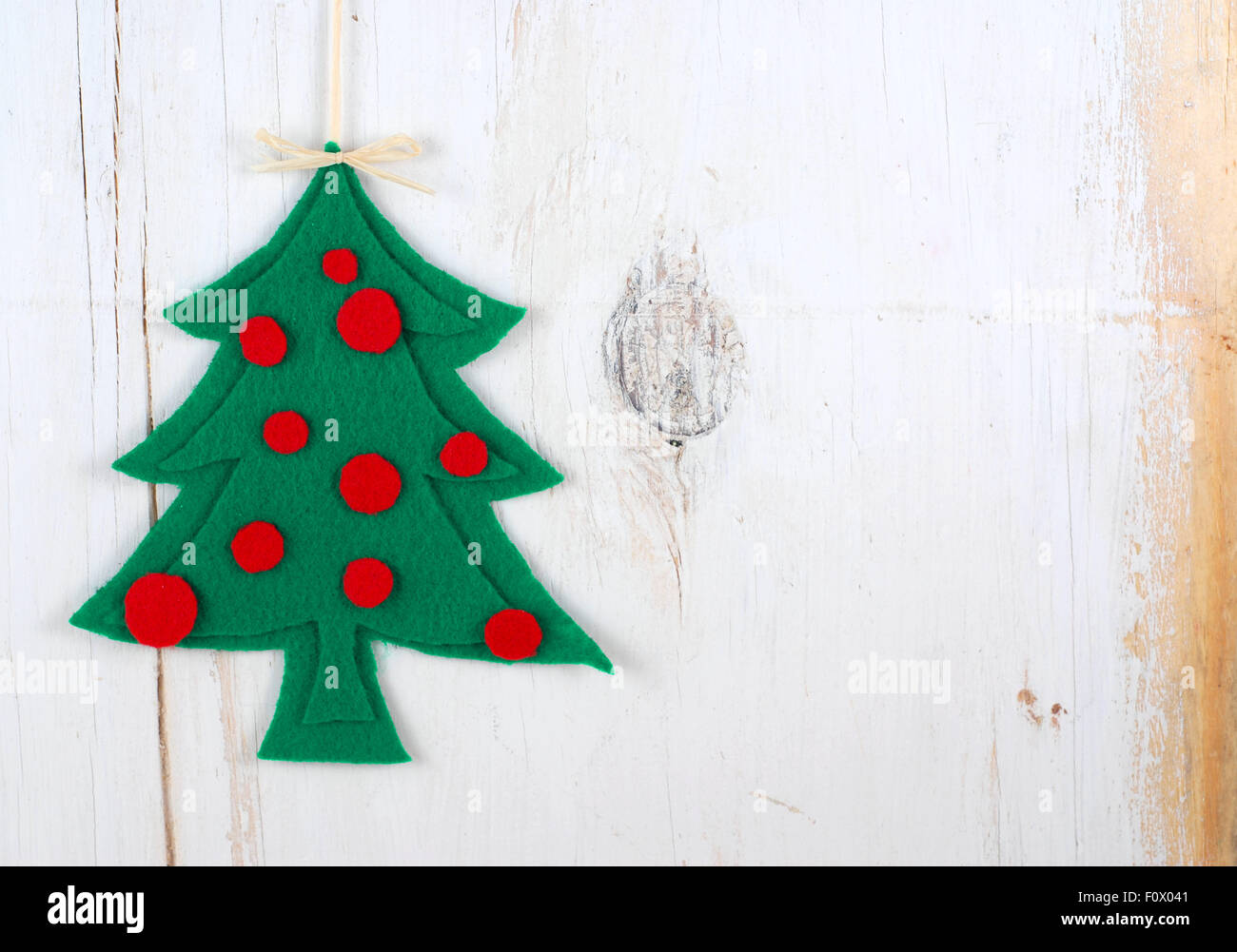 Rustic Christmas Image With Tree Cut Out Of Felt On White Washed Wooden Background