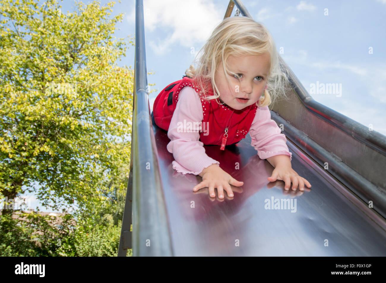 Little Girl Sliding Down Head First Stock Photo  86623846