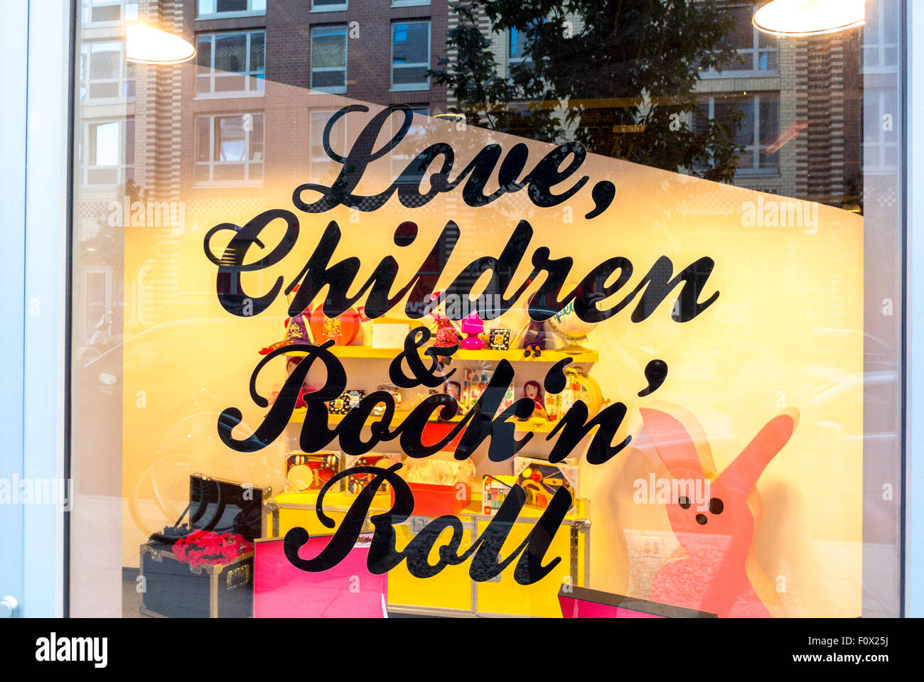 New York City, USA, Slogan in Local Children's Clothing Shop Front Window, Brooklyn District, DUMBO Area, 'Love - Stock Image