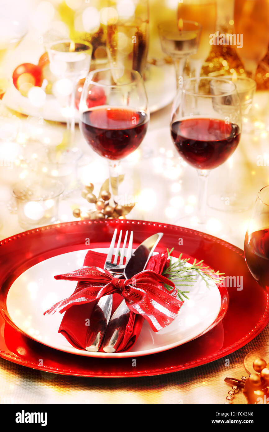 Red and gold themed holiday dinner table setting & Red and gold themed holiday dinner table setting Stock Photo ...