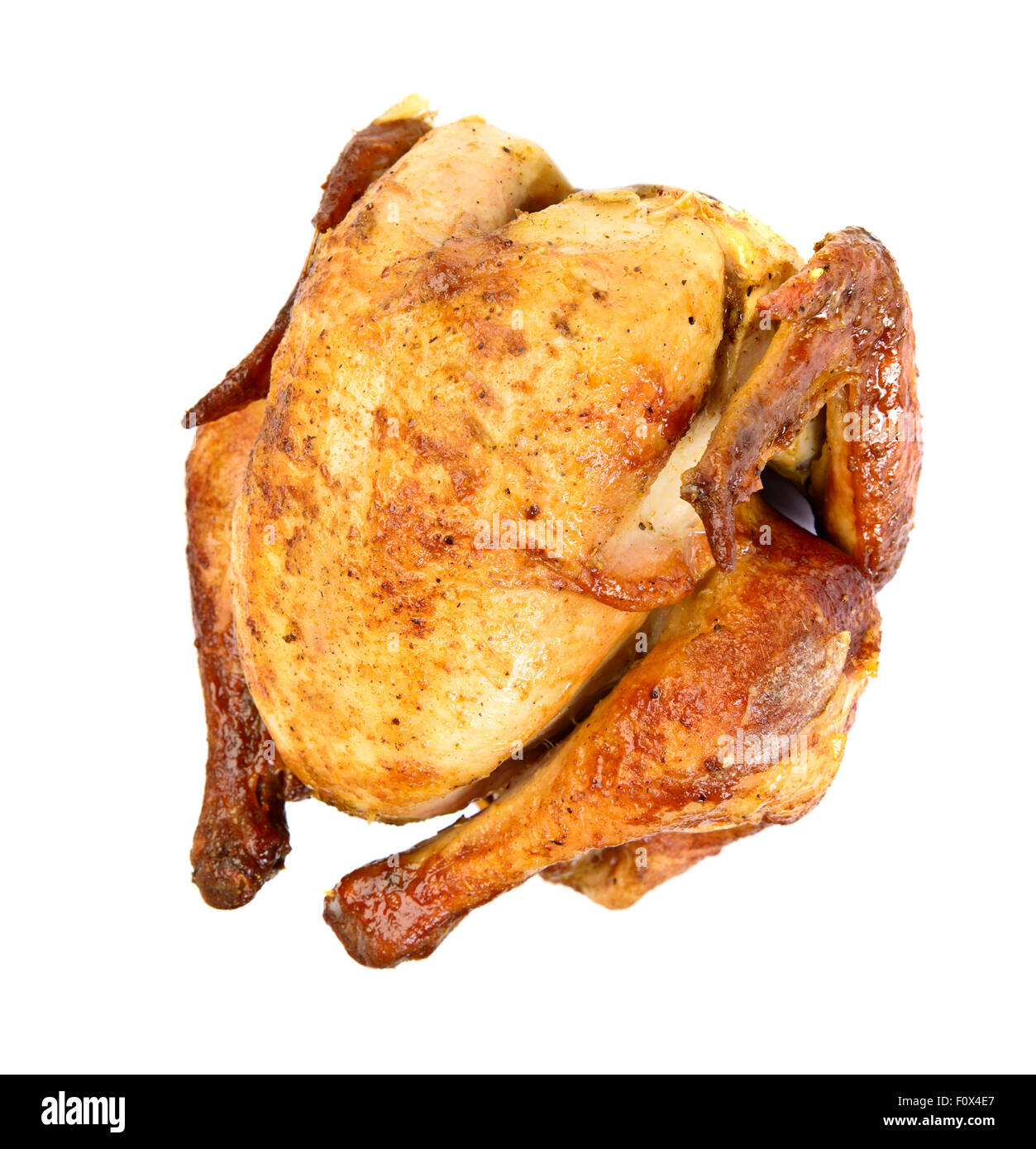 Grilled roast chicken over white - Stock Image