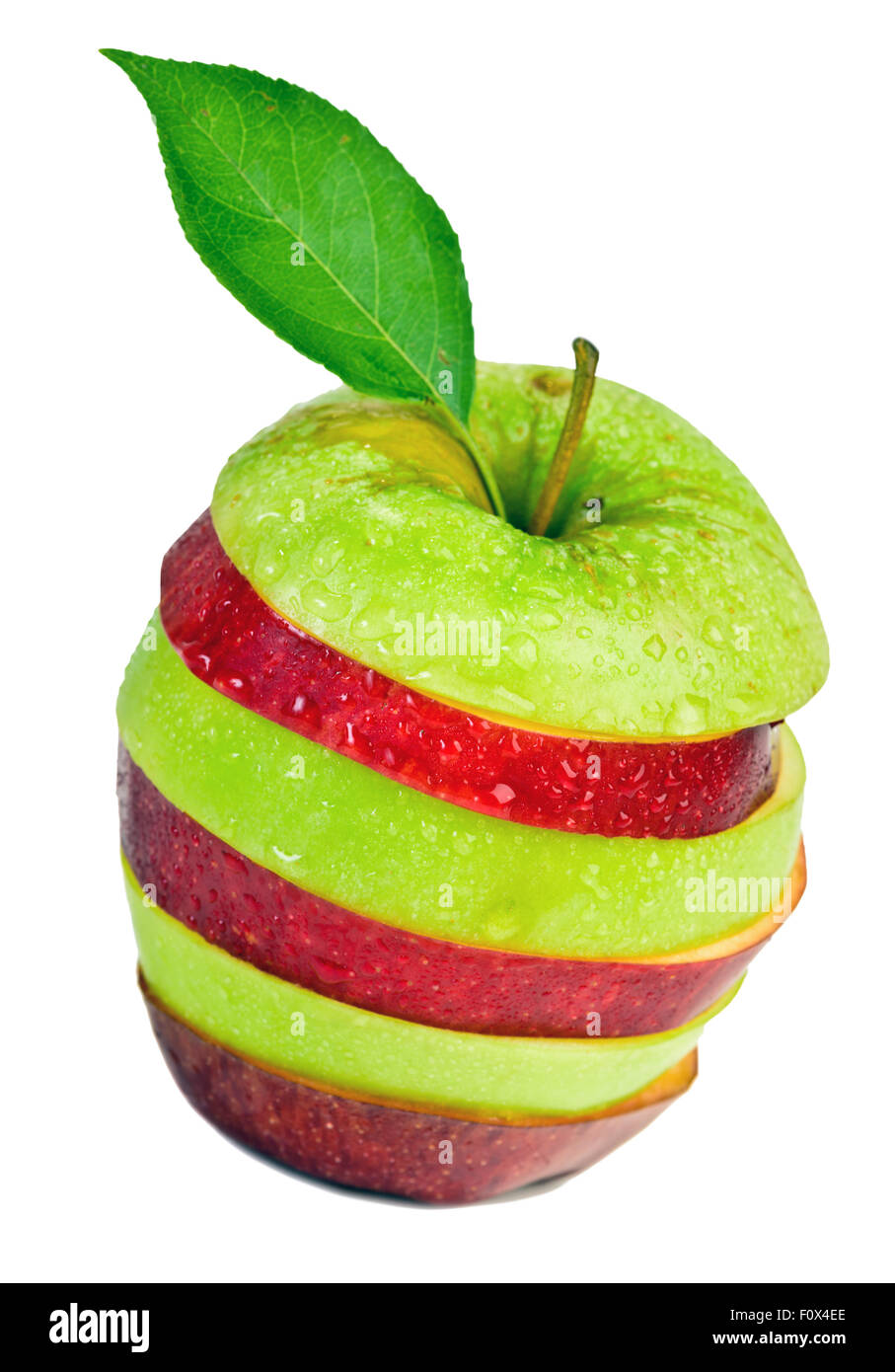 Sliced and mixed green and red apple on isolated white background - Stock Image