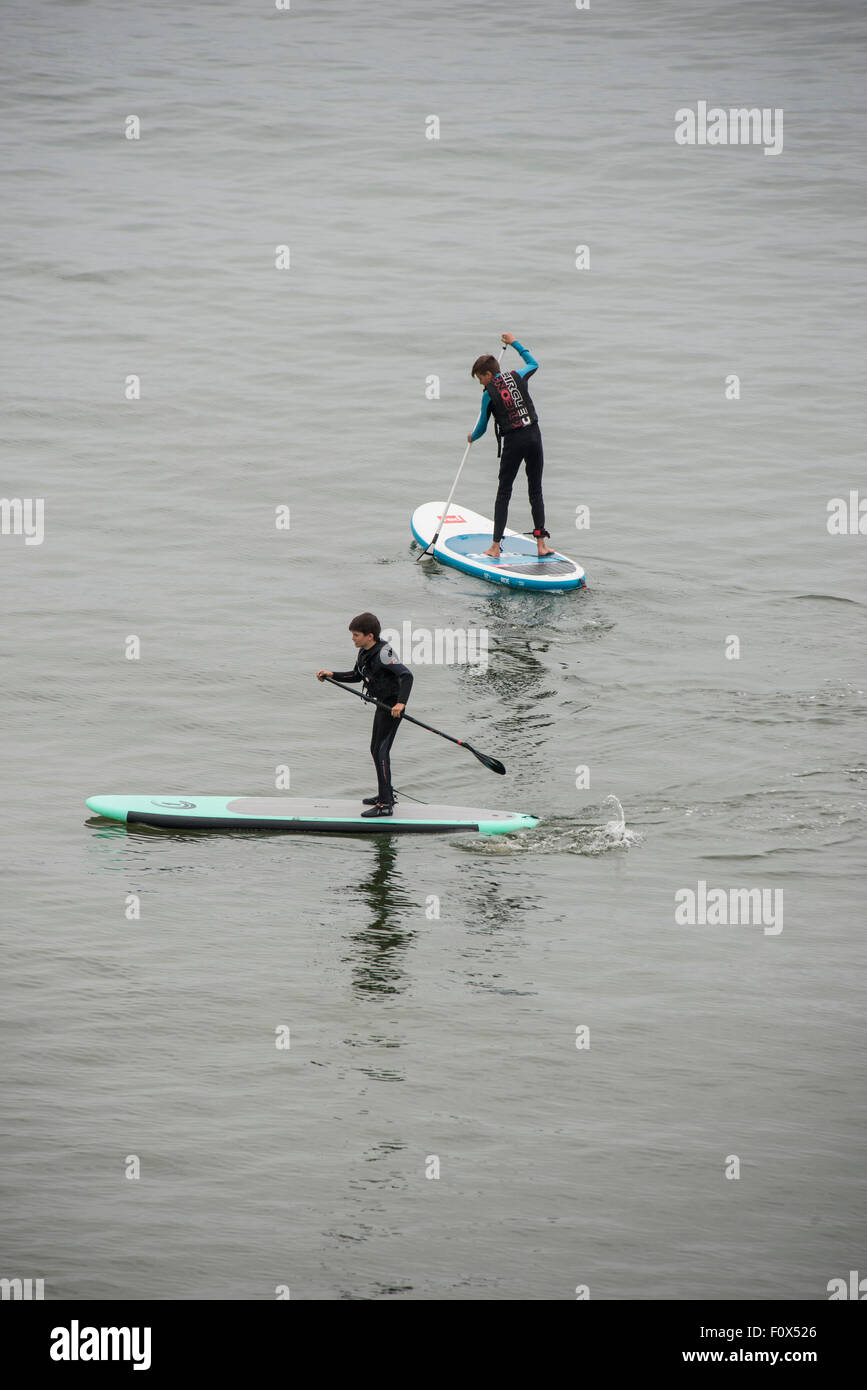 Coverack, Cornwall, UK. 22nd August, 2015. Paddle Boards in the rain at Coverack Cornwall England UK 22-08-2015 - Stock Image