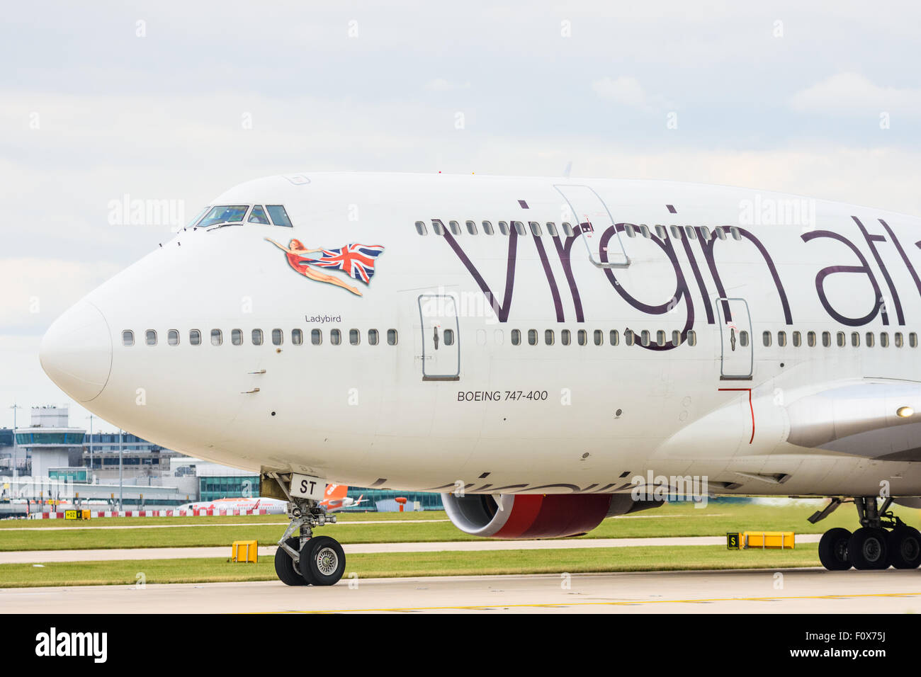 Side view of the front of a Virgin Atlantic Boeing 747-400 aeroplane on the runway at Manchester Airport Stock Photo