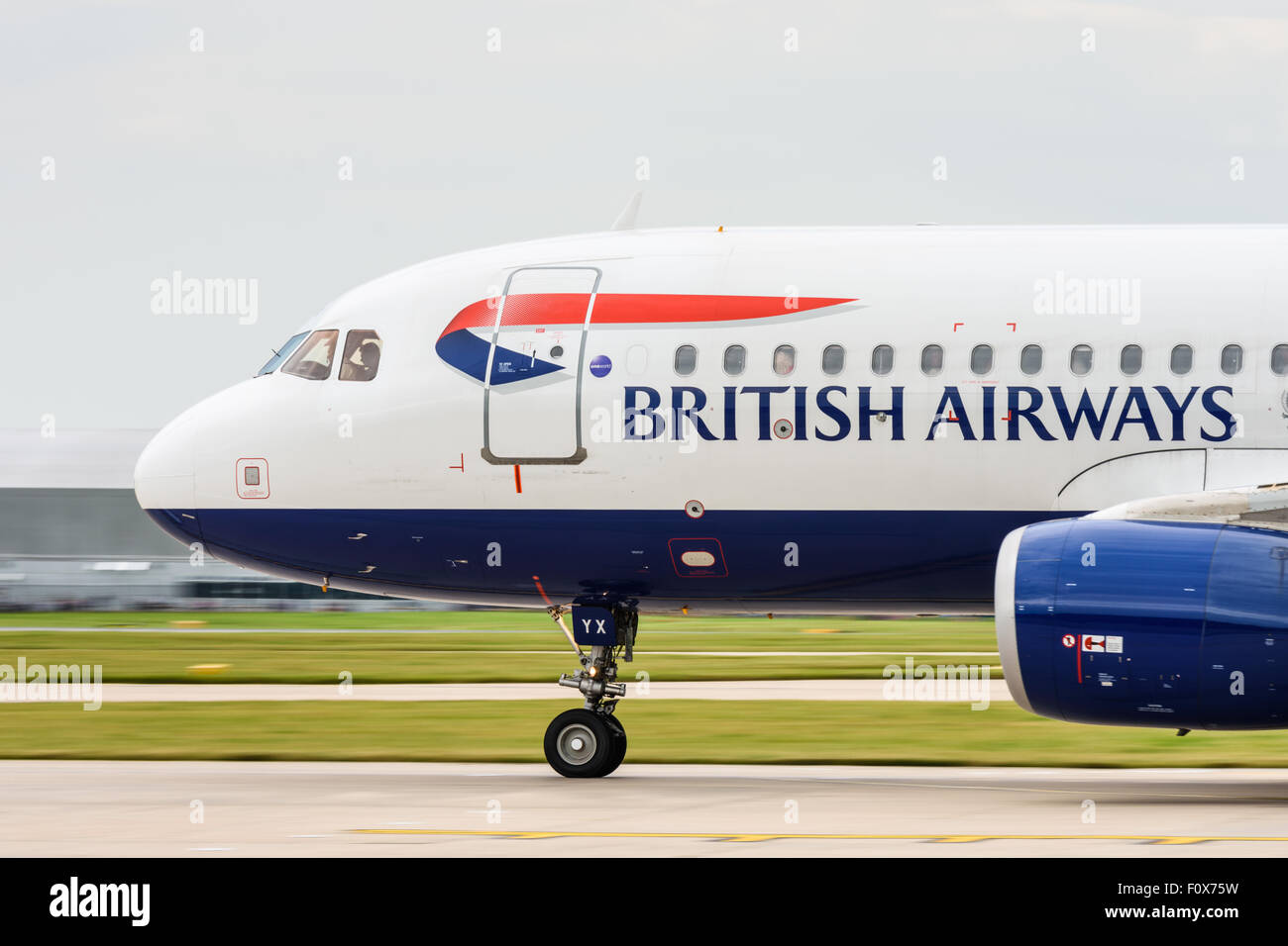 British Airways Airbus A320-200 aeroplane taking off from Manchester Airport - Stock Image
