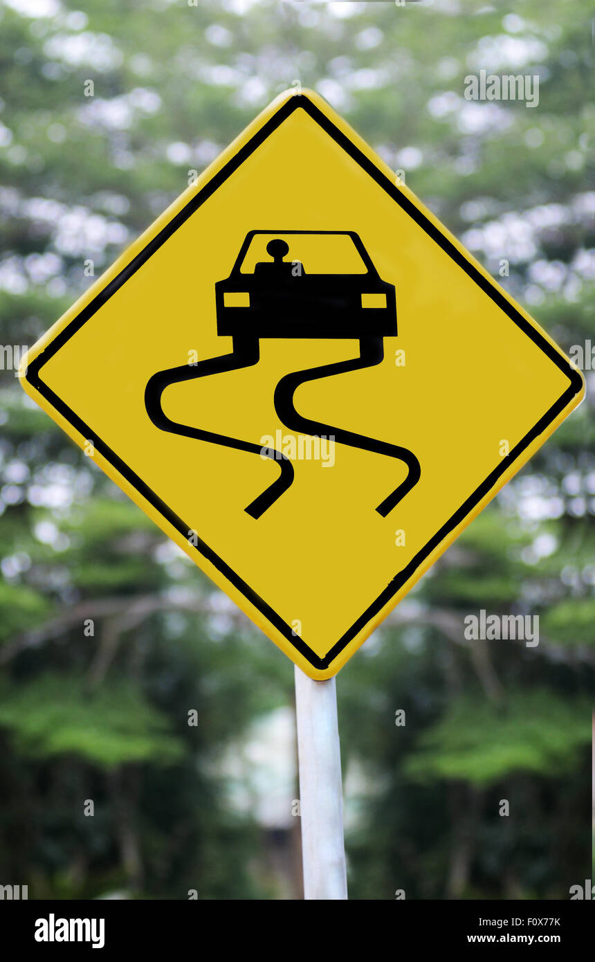 road sign slippery when wet, slow down - Stock Image