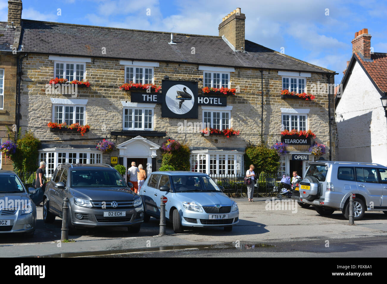 The Black Swan Hotel, luxury Boutique Hotel, with Tearoom, Cafe and people outside, on a summer's day. Helmsley, - Stock Image