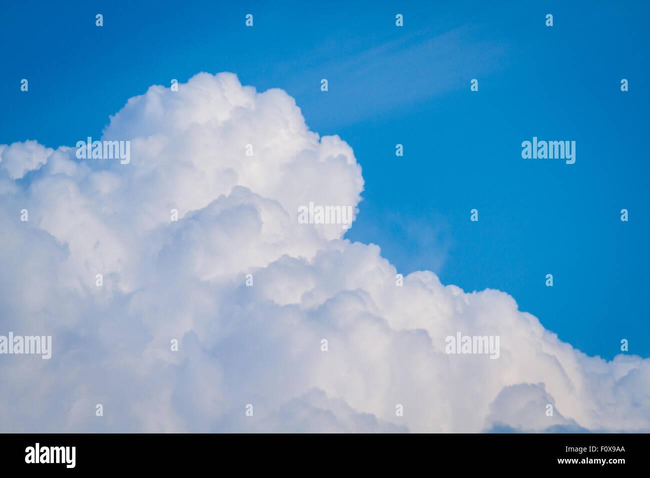 cumulonimbus clouds against a beautiful blue sky - Stock Image