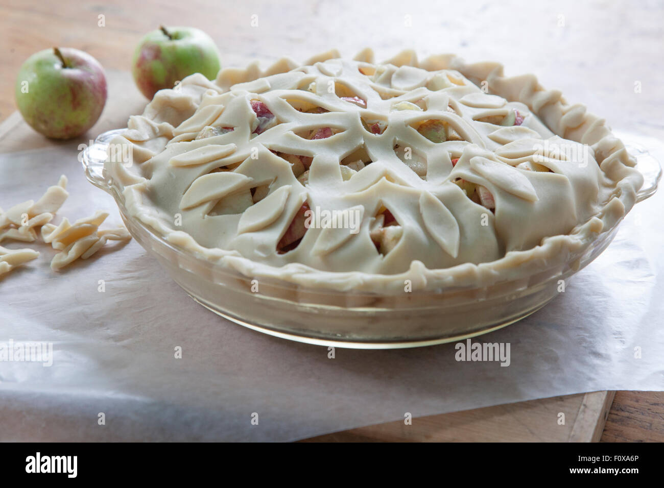 home made apple pie with lattice crust before baking - Stock Image