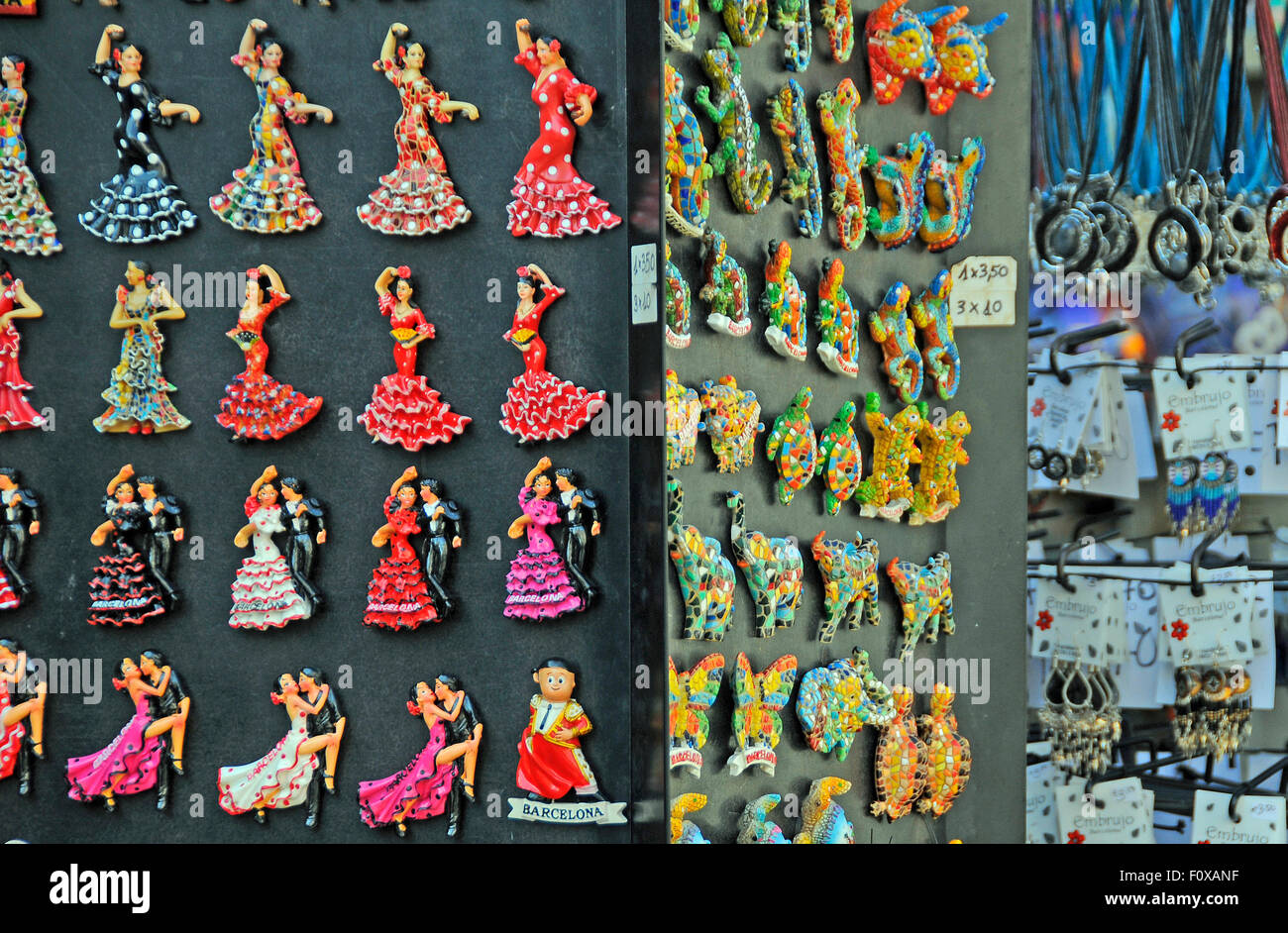 Souvenirs stall with fridge magnets on a stall at La Ramblas, Barcelona Spain - Stock Image