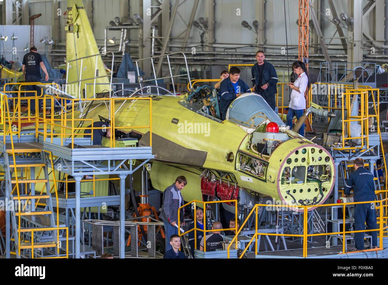 Komsomolsk On Amur, Russia. 16th July, 2015. A Sukhoi-35 fighter being assembled in a workshop at the Gagarin Aircraft Stock Photo