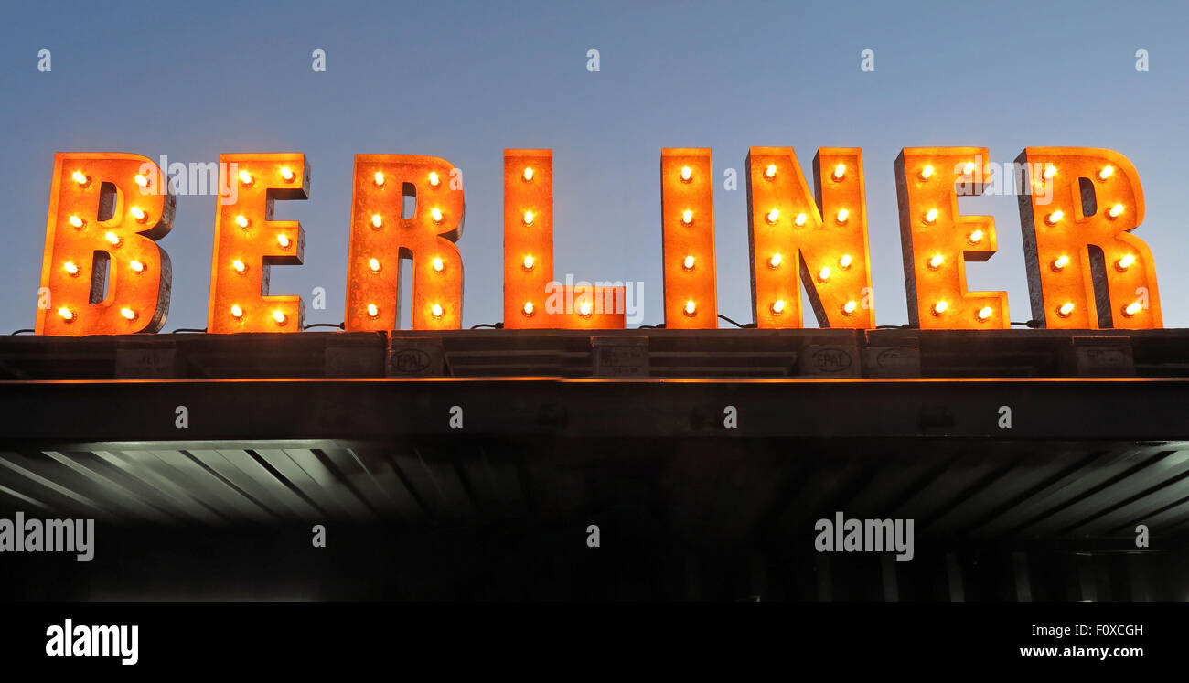 Berliner sign in lights with sky behind, bar serving bier Stock Photo