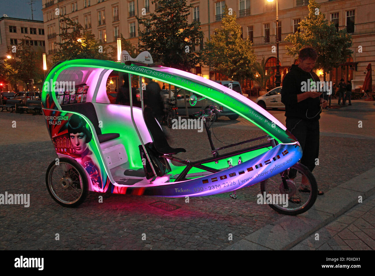 Berlin city Cycle Rickshaw at night, Germany - lights on - Stock Image