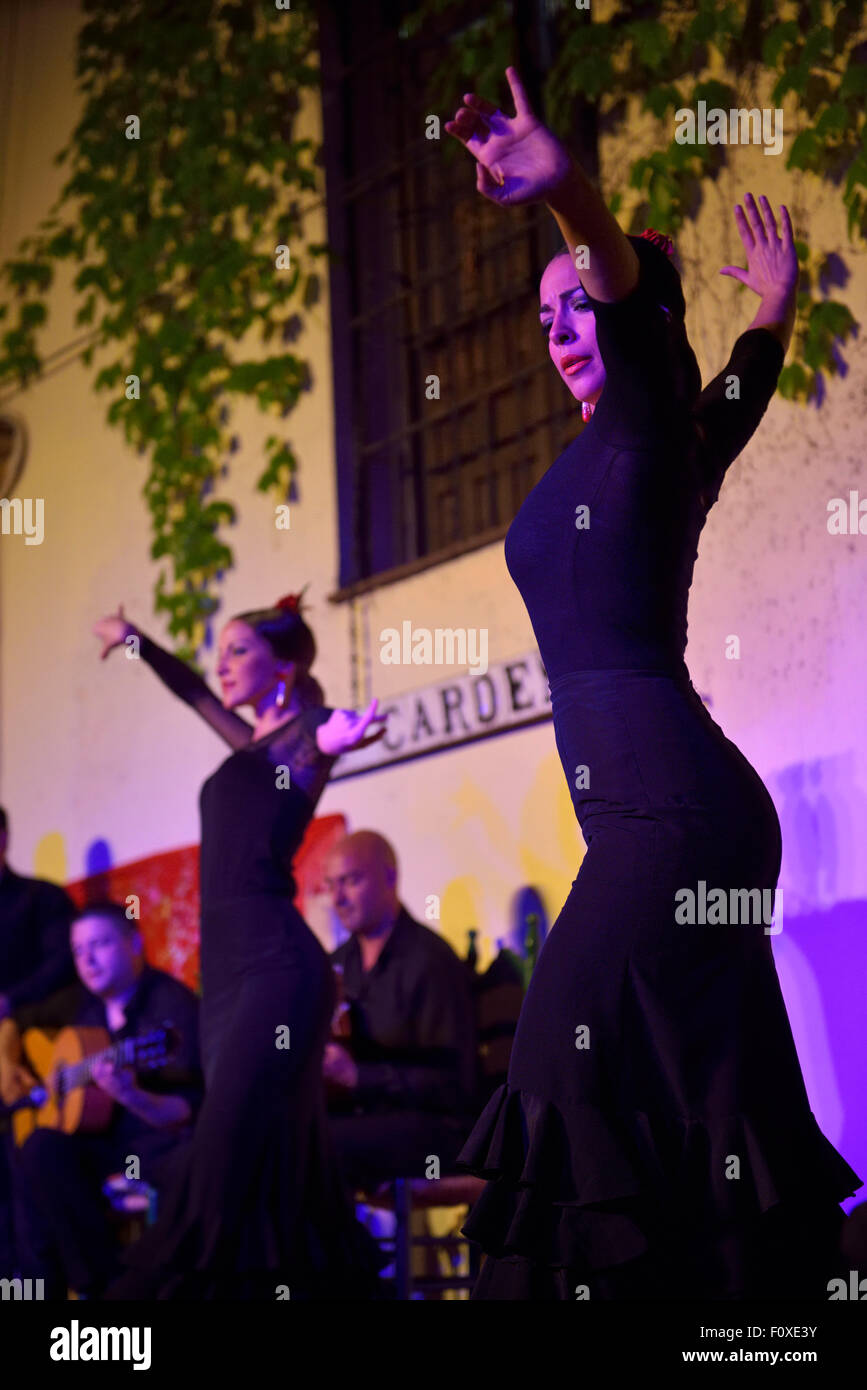 Female Flamenco dancers on stage at night in an outdoor courtyard in Cordoba Spain Stock Photo
