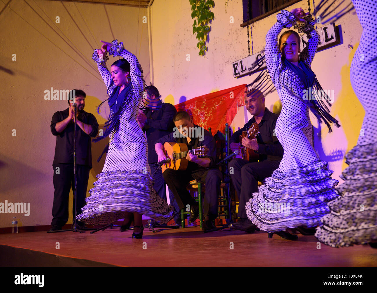 Spinning female Flamenco dancers on stage at night in an outdoor courtyard in Cordoba Spain - Stock Image