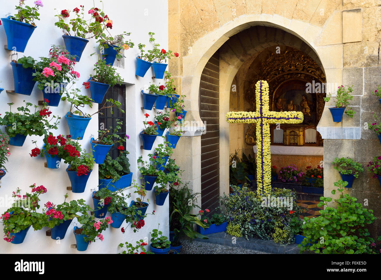Our lady of Bethlehem and Shepherds Chapel with flower pots in courtyard during Spring festival Cordoba Spain - Stock Image