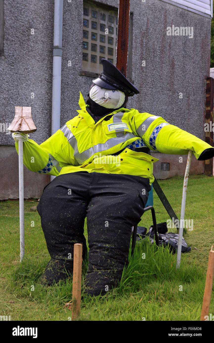Policeman scarecrow outside Kames Police station near Tighnabruaich in Argyll Scotland, part of the annual Scarecrow - Stock Image