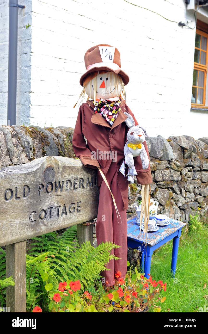 Mad Hatter from Alice in Wonderland, part of the secret coast Scarecrow Trail around Tighnabruaich in Argyll, Scotland - Stock Image