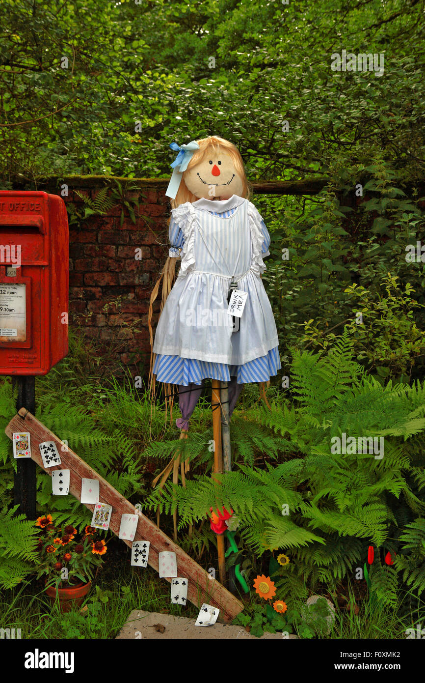 A scarecrow of Alice from Alice's adventures in Wonderland - Stock Image