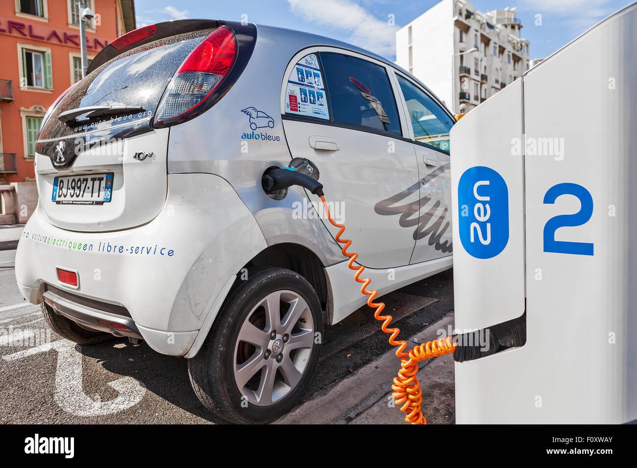 electric city car recharging stock photos electric city. Black Bedroom Furniture Sets. Home Design Ideas