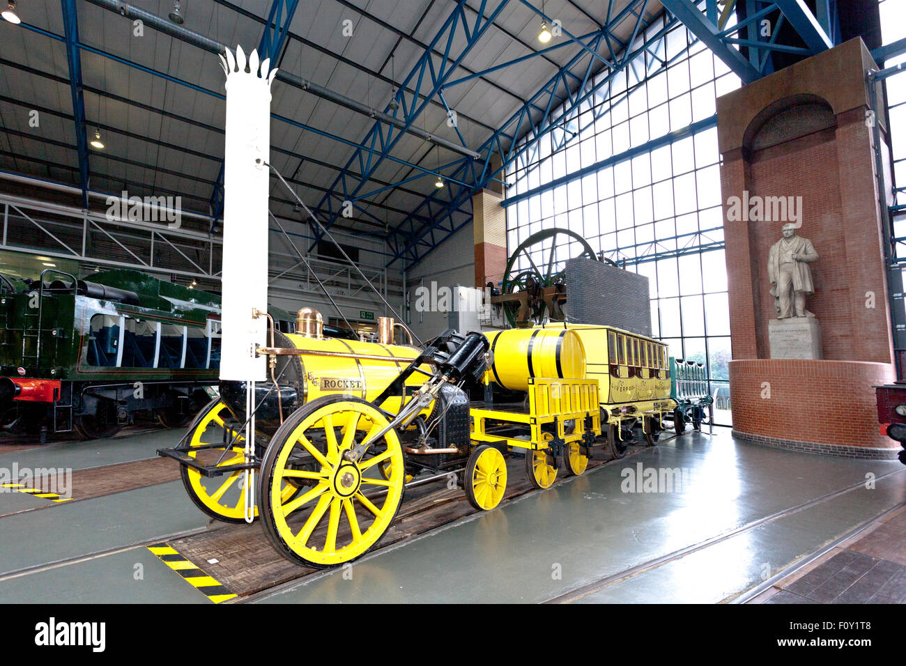 A replica of George Stephenson's 'Rocket' in the Main Hall of the National Railway Museum, York, England, - Stock Image