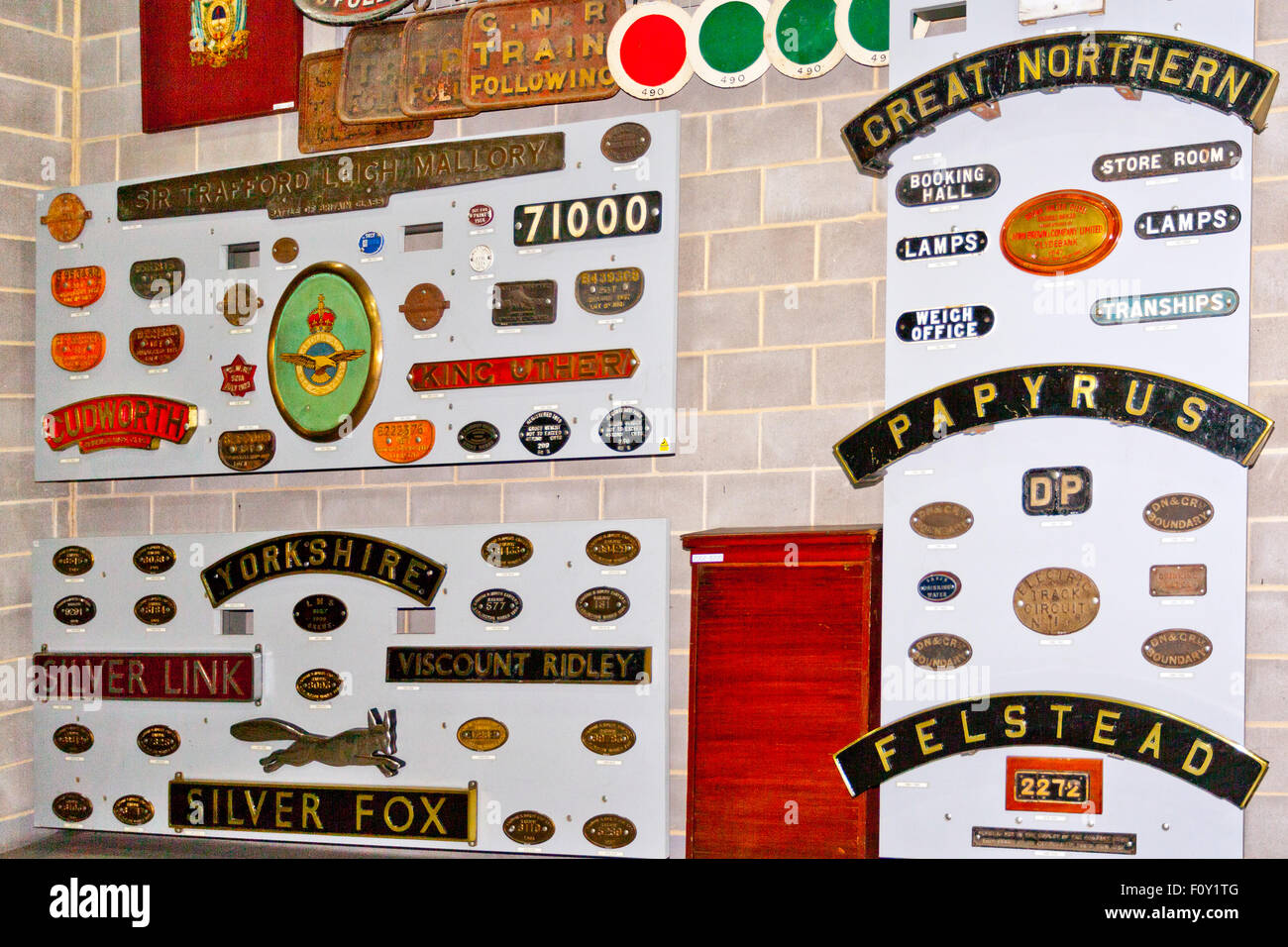 A display of historic assorted locomotive nameplates and makers plates in the National Railway Museum, York, England, - Stock Image