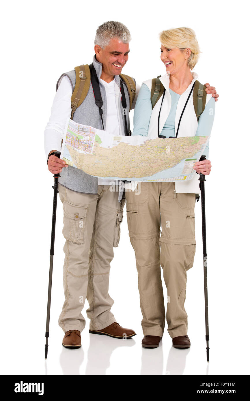 cheerful middle aged couple checking directions on a map isolated on white background - Stock Image