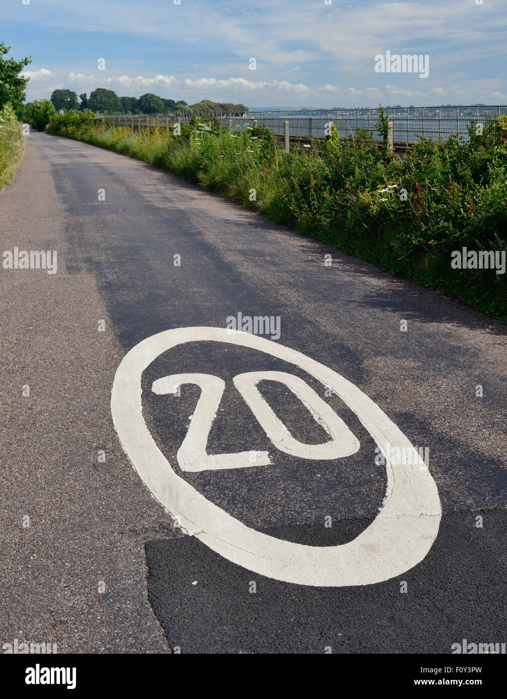 20 mph speed limit sign on minor country road. - Stock Image