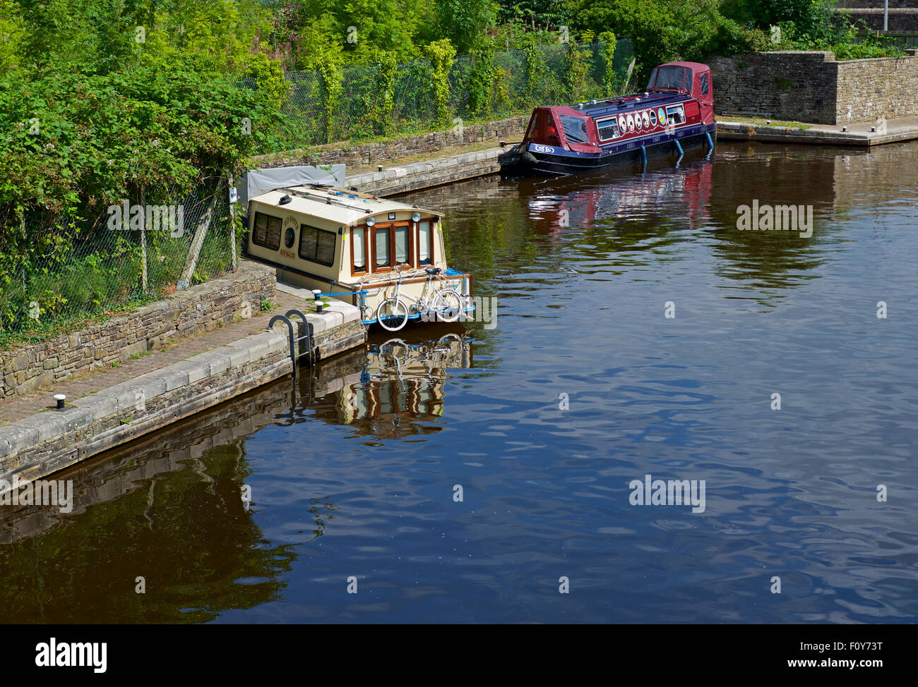 Two narrowboats on the Brecon and Monmouthshire Canal, Powys, Wales UK - Stock Image