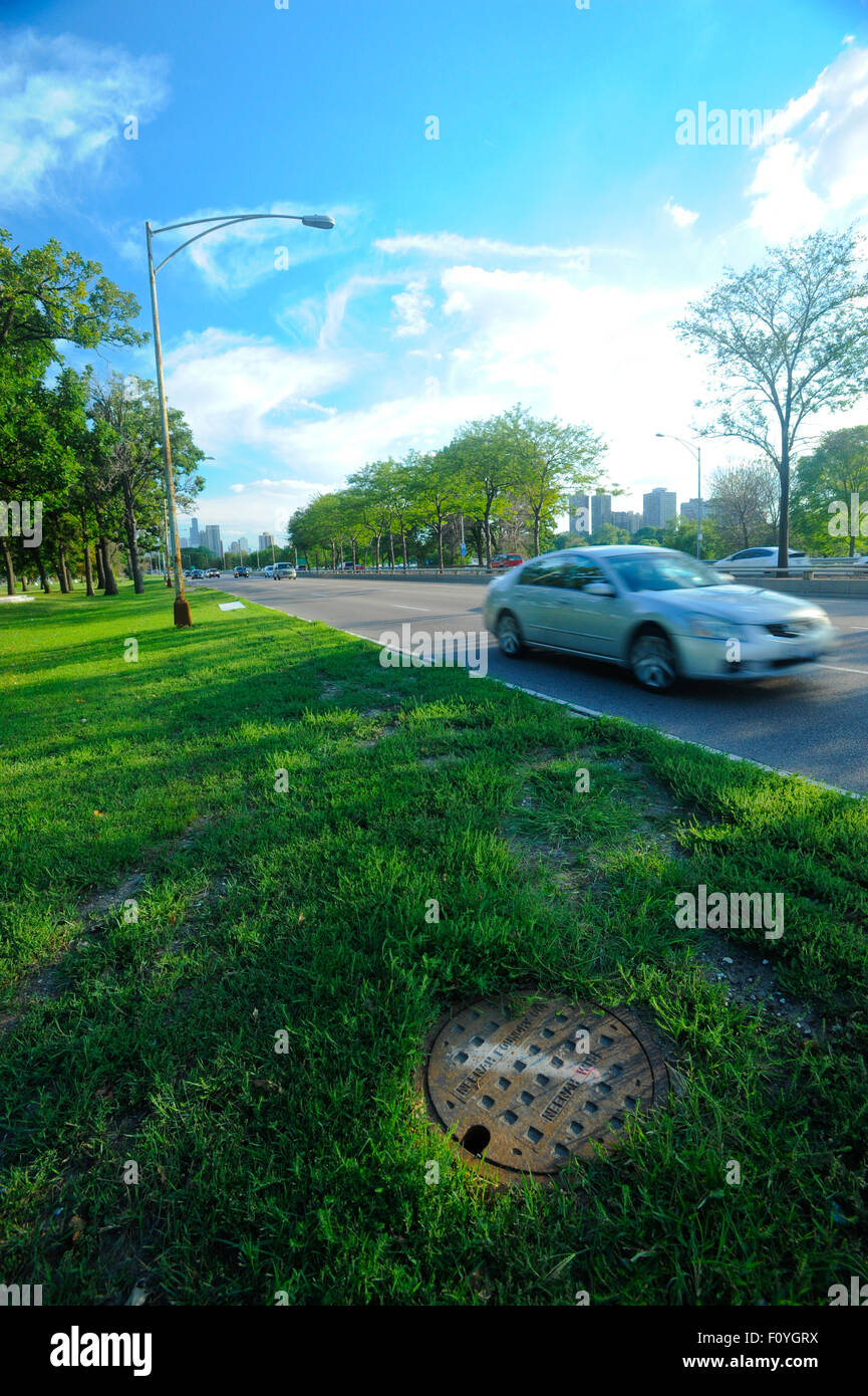Manhole storm sewer along Lake Shore Drive in Chicago, Illinois - Stock Image