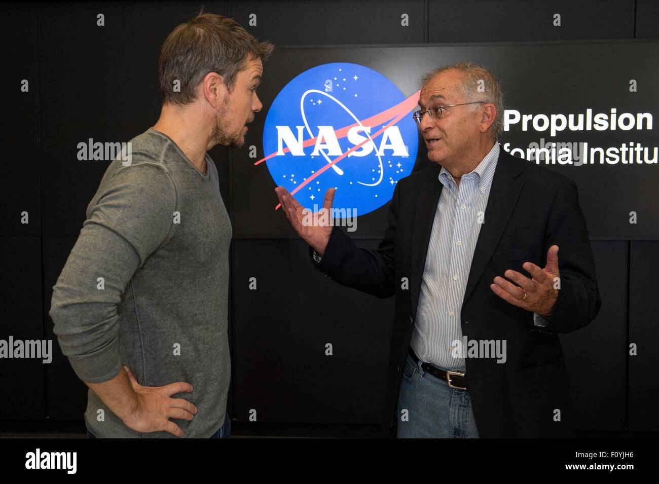 Actor Matt Damon is welcomed during a visit to the Jet Propulsion Laboratory by Director Charles Elachi August 18, - Stock Image