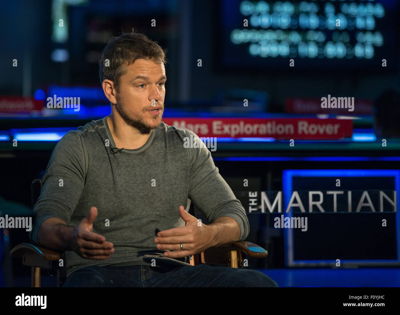 Actor Matt Damon sits in mission control for an interview during a visit to the Jet Propulsion Laboratory August - Stock Image