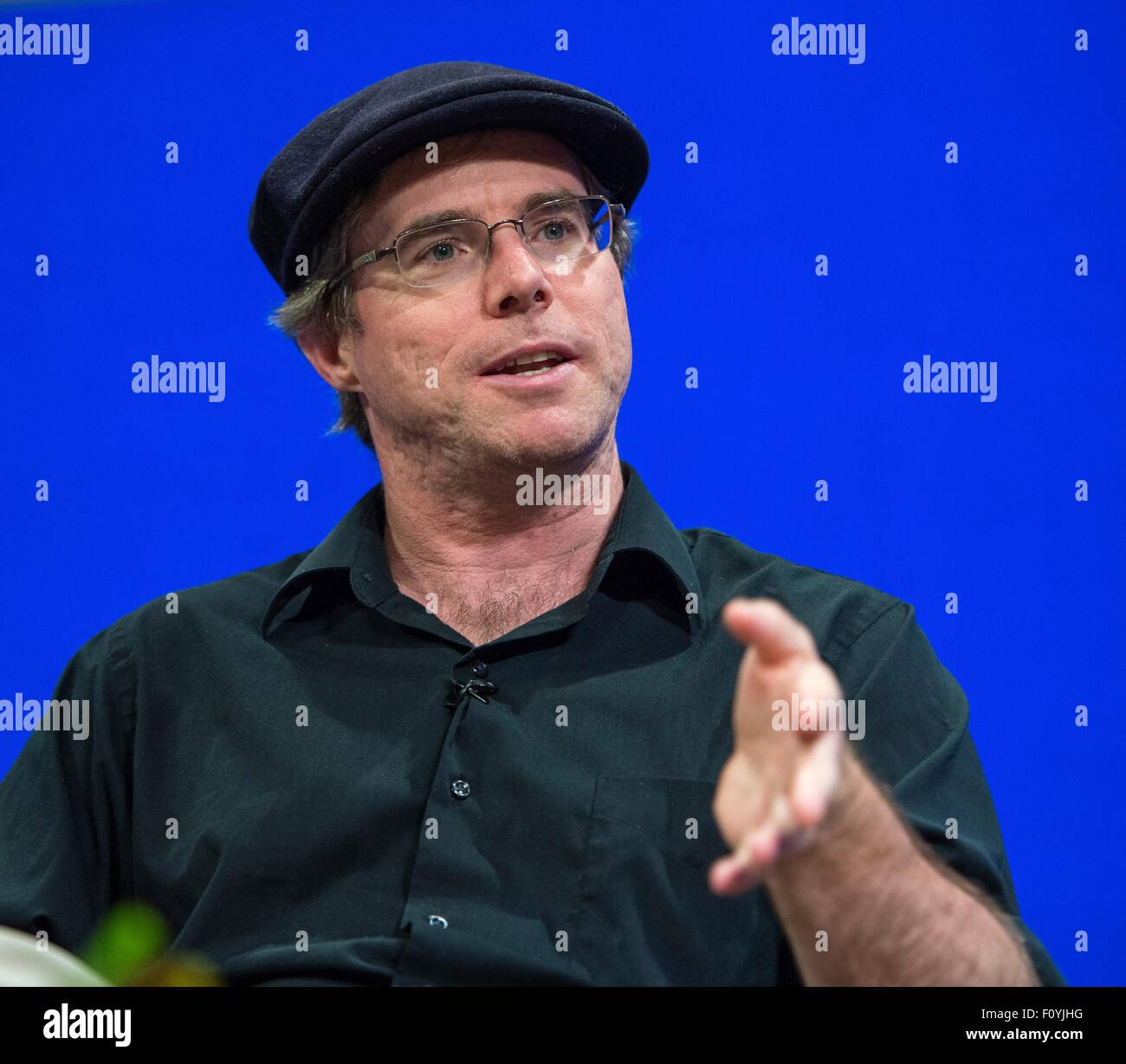 Author and screenwriter Andy Weir participates in a question and answer session about Mars and the soon to be released - Stock Image