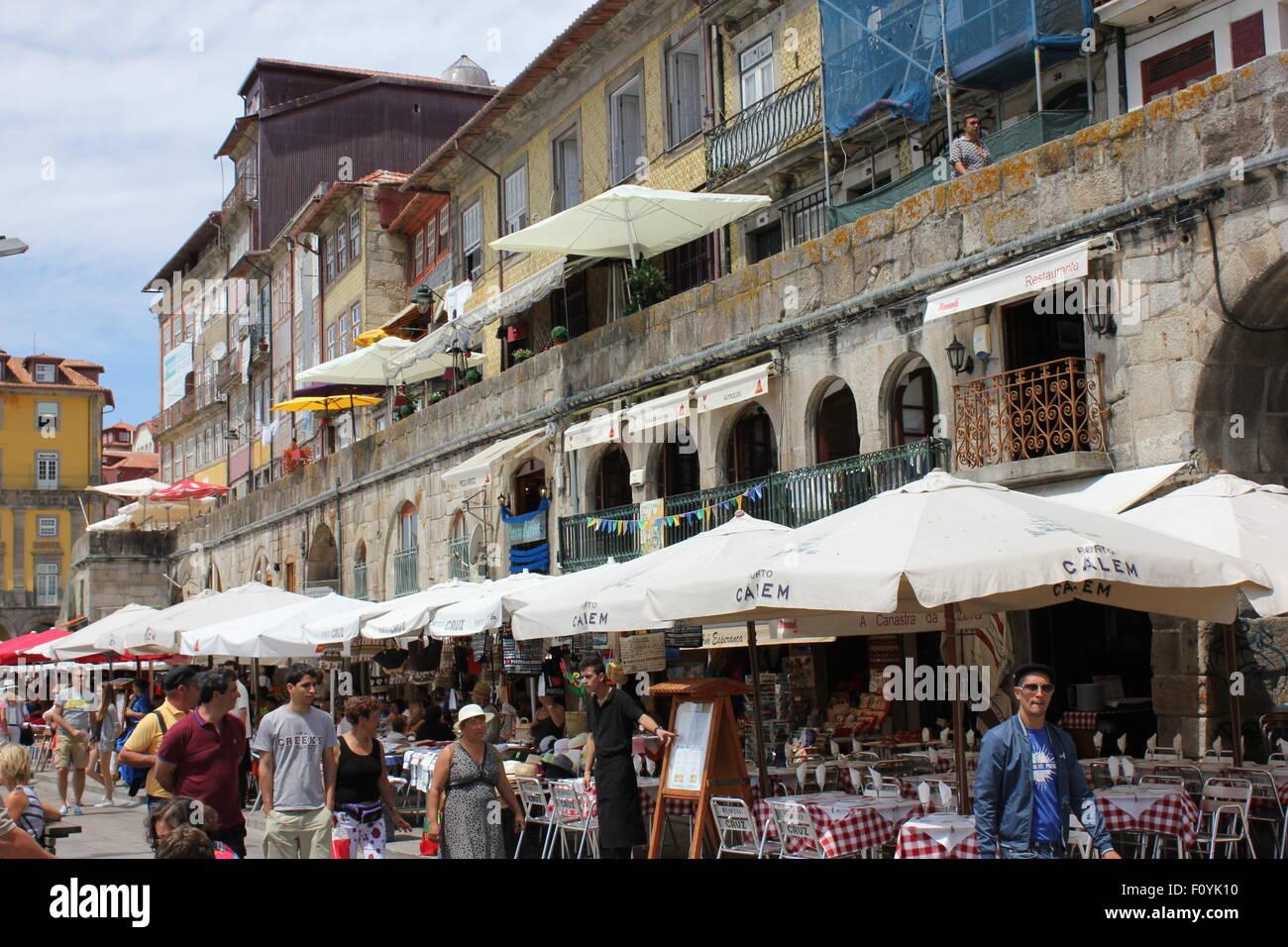 Restaurants with shade umbrellas in Porto, Portugal - Stock Image