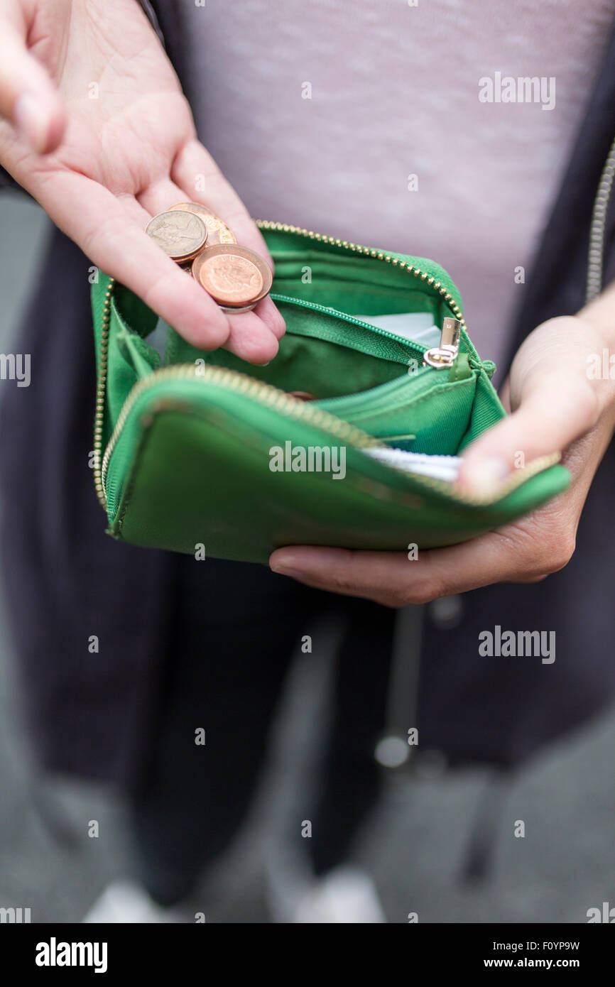 change in a woman's purse - Stock Image