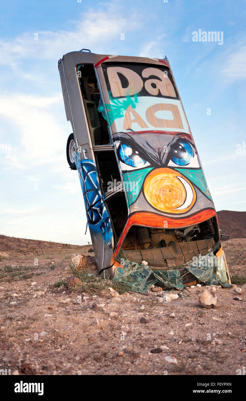 Junk car artistically buried in the desert near Goldfield Nevada - Stock Image